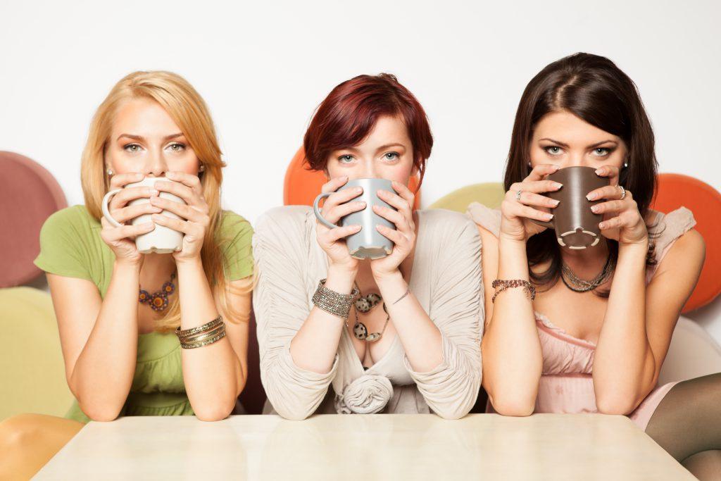 3 women drinking hot drinks.