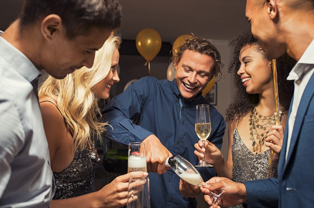 neighbours indulging in champagne at a house party - New Year's Eve ideas for singles