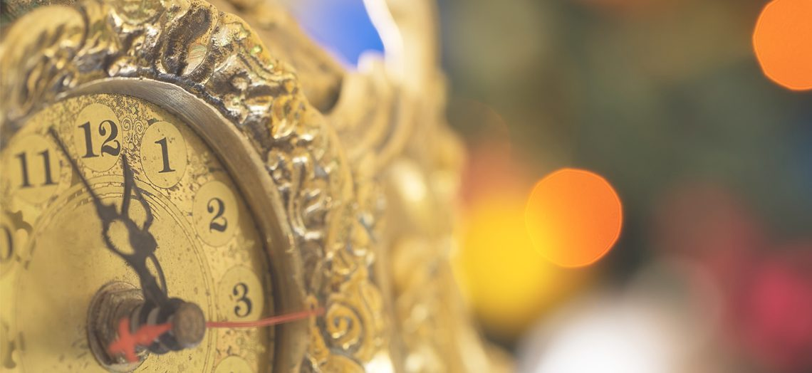 Gold clock almost at midnight - New Year's Eve ideas for singles